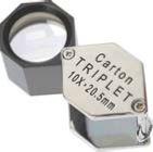 Carton swing out inspection loupe